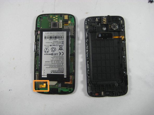 Disconnect the connection between the Battery and the Mother Board by using the Pry tool.