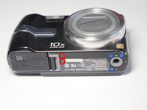 Remove 5 screws from the base of the camera.