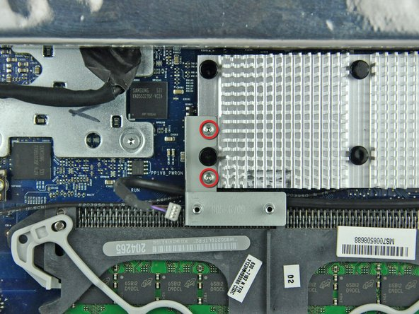 Remove the two T6 Torx screws securing the IR board bracket to the aluminum heat sink on the logic board.