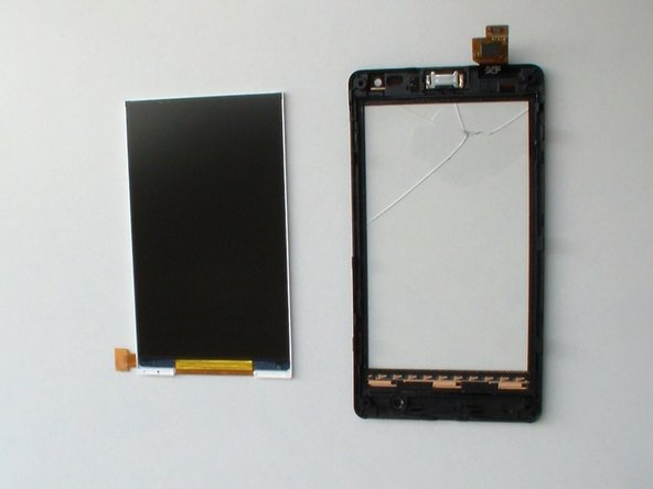 The display is very fragile, do the separation very carefully.