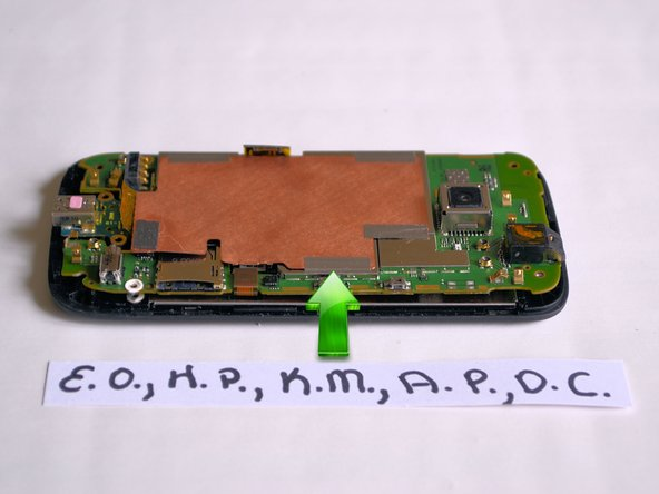 With one hand holding the device in place, use your free hand to flip open the RF shield.