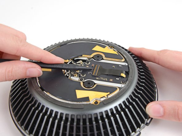 Use the tip of a spudger to flip the ZIF retaining tab on the fan assembly ribbon cable connector.