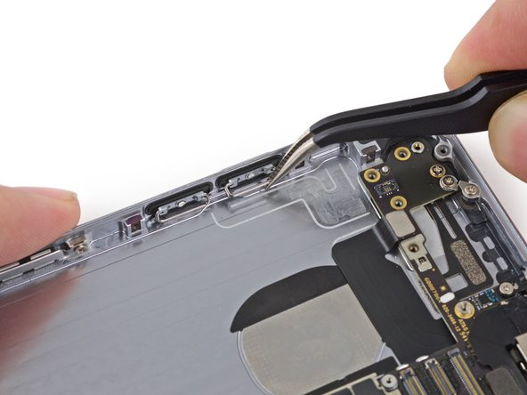 Pull the volume control buttons by the metal bar to remove them from the rear case.