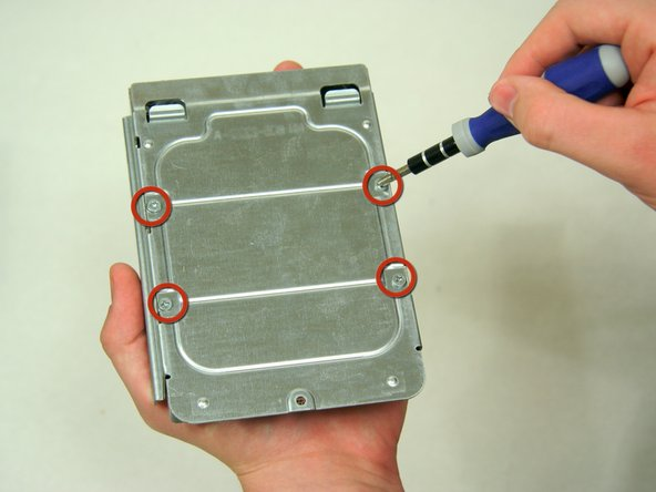 To remove the Hard Drive from the tray, unscrew the 4 screws on the bottom of the tray.