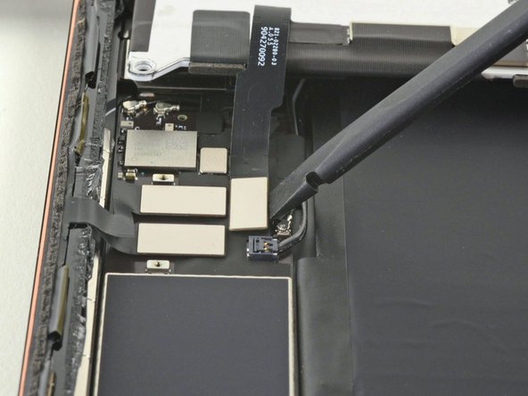 Use the flat end of a spudger to disconnect the LCD cable by lifting straight up on the press connector.