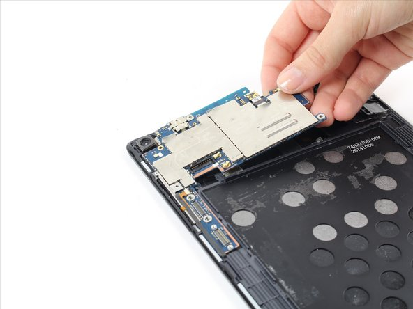 Gently lift the motherboard up from the device.