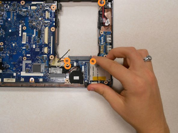 Using a Phillips #00 screwdriver, remove the four (4) 5mm screws holding the motherboard in place.
