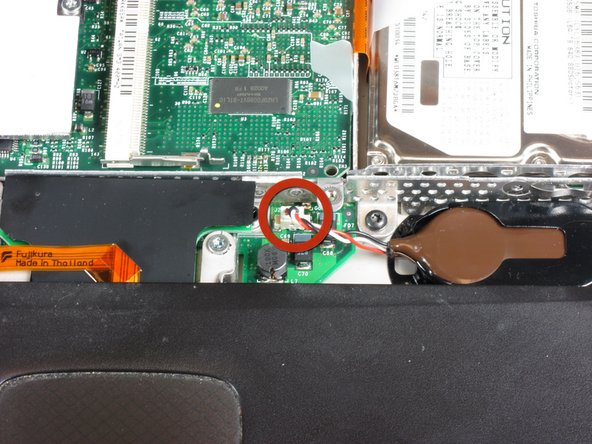 Pull the PRAM battery cable vertically upward to disconnect it.