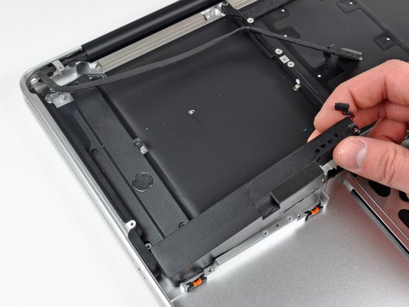 Lift the subwoofer and right speaker assembly out of the upper case.