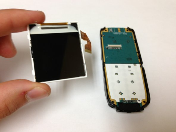 You should now see the screen on the front side of the phone. Wedge your finger to the side of the phone.  Apply some force to pop out the screen.