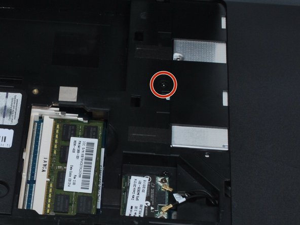 Use a PH0 screwdriver to remove the single screw holding in the optical drive.
