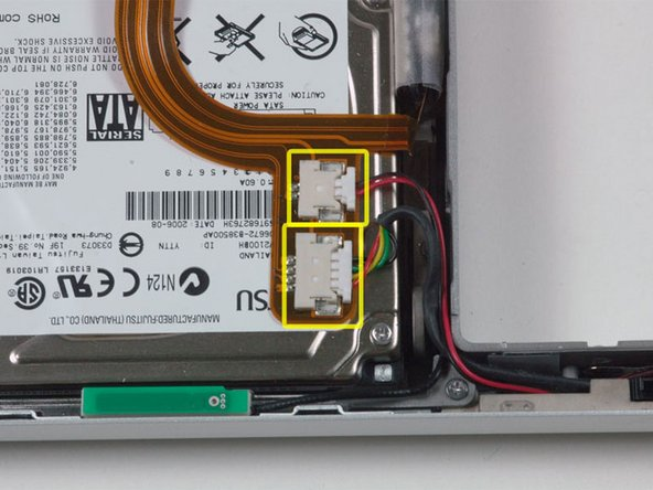 Disconnect the IR and sleep light cables from their connectors above the hard drive.