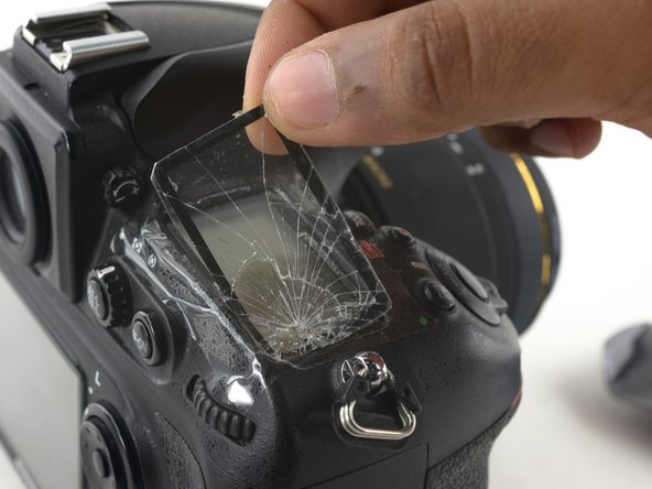 Once the glass is mostly separated from the camera, peel the panel completely off the LCD screen.