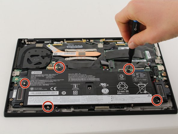 Remove five 5mm Phillips #0 screws from the edges of the battery.