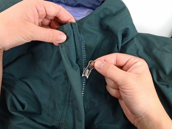 Slide the slider off of the garment.