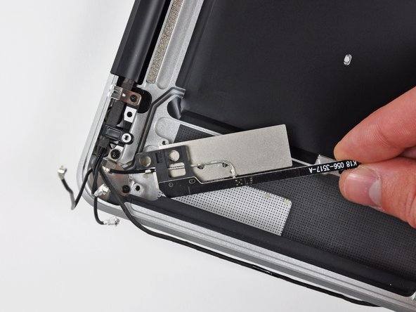 Since the AirPort/Bluetooth board is mounted inside the all-metal case of this machine, Apple added an antenna that is mounted on the frame for the optical drive opening. Pretty clever!