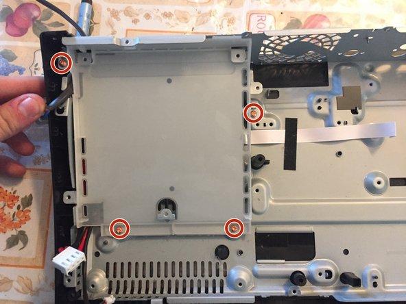 Remove the four orange PH2 screws.