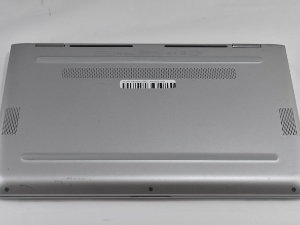 Lay the HP Pavilion top-down with the front edge facing towards you.