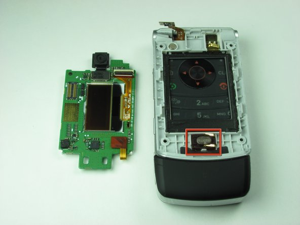 Ignoring the top logic board, take the phone in your hand and turn your attention towards the speaker.