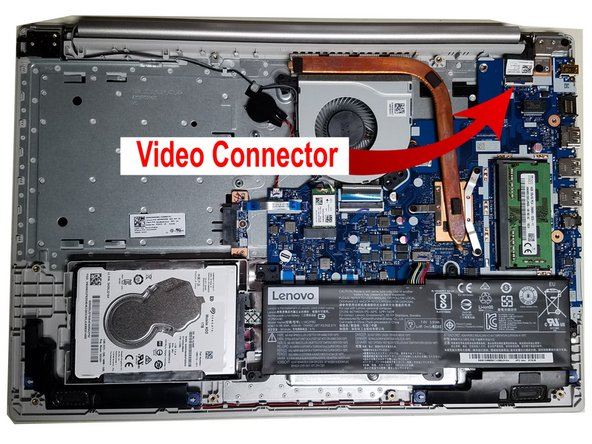 1- Use a finger nail or nylon spudger to flip up the latch holding in the video cable.