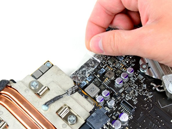 Remove the strip of tape securing the GPU thermal sensor cable to the logic board.