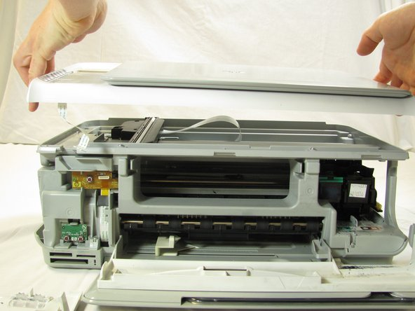 Carefully lift the top panel of the printer away from the printer body.