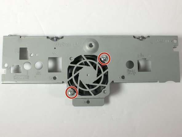 """Remove the two 1-64 x 1/2"""" machine screws and the retaining nuts that fasten the cooling fan to the rear panel using the Phillips #0 screwdriver and the 5/32"""" socket."""