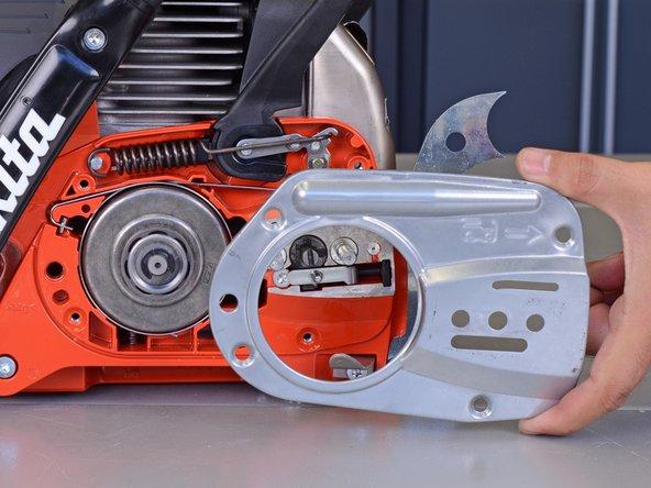 Remove the chain brake cover.