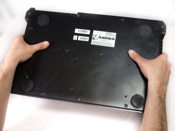 Carefully flip the device to the front making sure you secure the face plate and the chassis together.