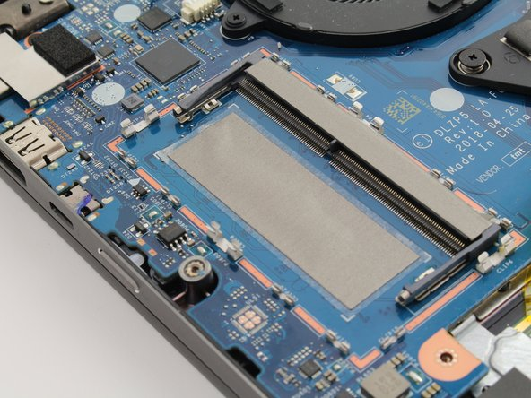 New RAM can be inserted into the slot below the metal cover.