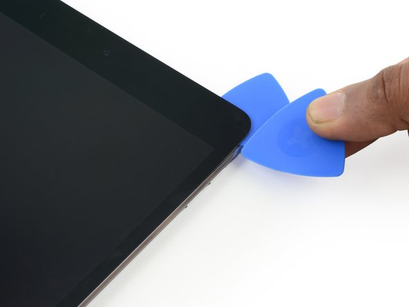 Insert a new opening pick and slide it down the right edge of the iPad, releasing the adhesive as you go.