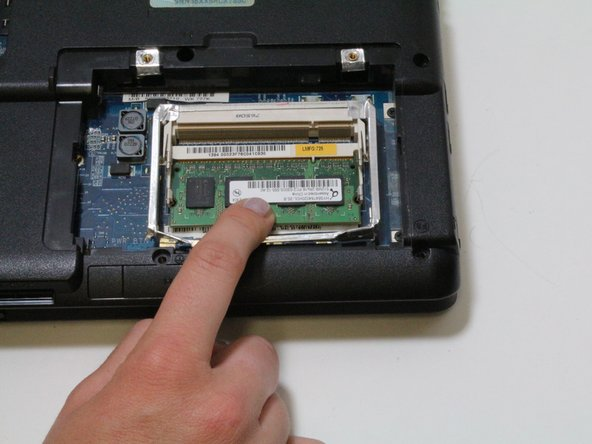 Insert new RAM chips here. Be sure that you are putting it in the right way by comparing the gold connectors to the shape of the slot.