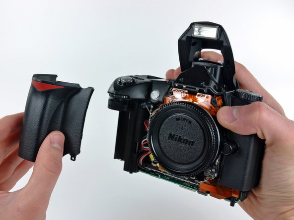 Remove the grip from the D70.