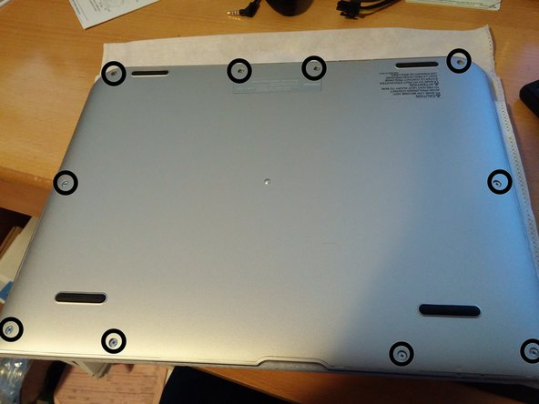 With the keyboard separated remove all the screws in the bottom. The top 4 screws are longer then the bottom 6.