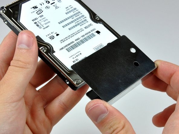 Pull the hard drive shield off the hard drive.