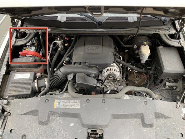 The battery is located in the back left corner of the engine bay, partially covered by an engine bay brace.