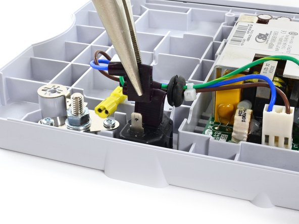 Unplug the AC power harness connectors from the IEC connector with a pair of pliers.