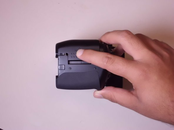 Slide the memory card door in the direction of the arrow engraved on the camera.
