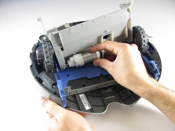 To remove the motor, simply pull it out gently from the plastic brush holder.
