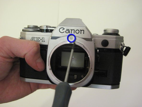 Remove the first set of two #00 phillips screws from the lens outer casing