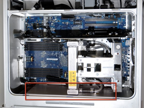 Locate the power supply in the Apple G5 computer. It is located  under the metal plate at the bottom of the computer case.