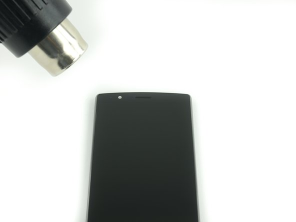 Use a heat gun or an iOpener to soften the adhesive underneath the edges of the screen.