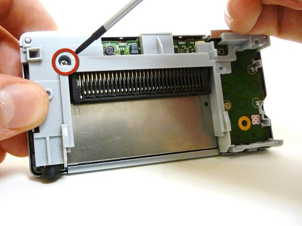 Remove the two Phillips #00 screws from the plastic frame.