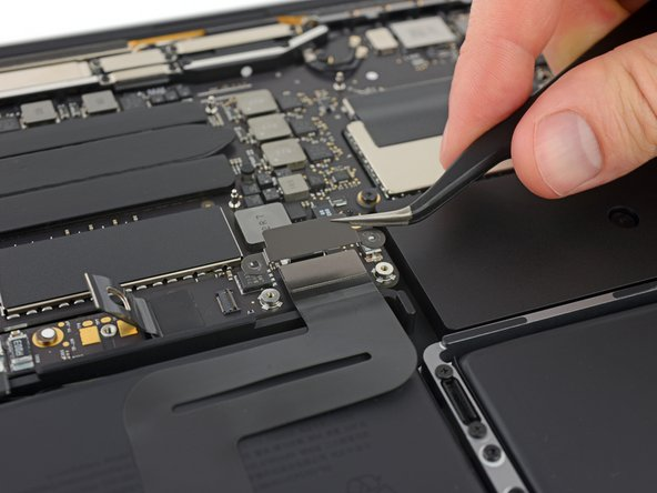 Remove the trackpad cable connector bracket.