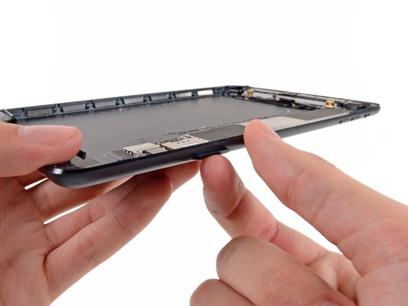 Use a fingernail to pull the SIM card tray out from the iPad.