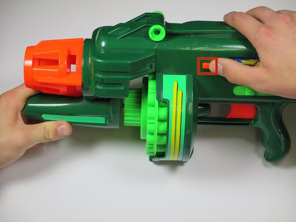 Locate the orange slider on the front side of the gun.
