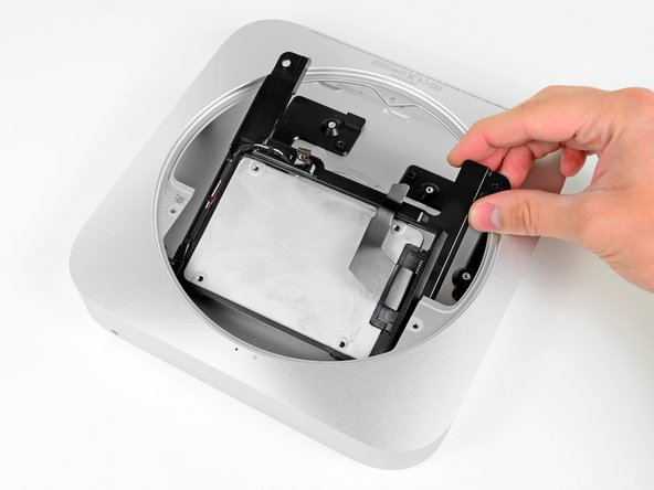 Install the second hard drive assembly into the outer case.