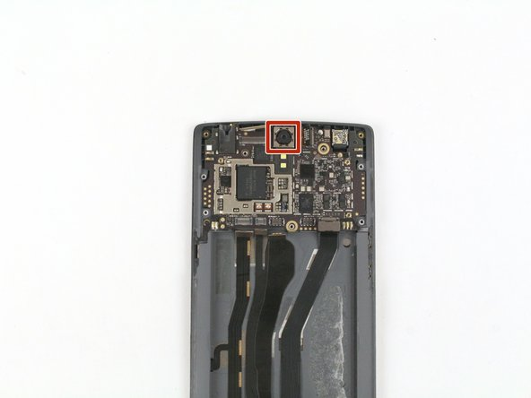 Using a pair of tweezers, gently lift the front facing camera out of the device.