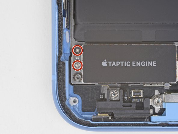 Remove the two 1.8 mm Phillips screw securing the Taptic Engine.