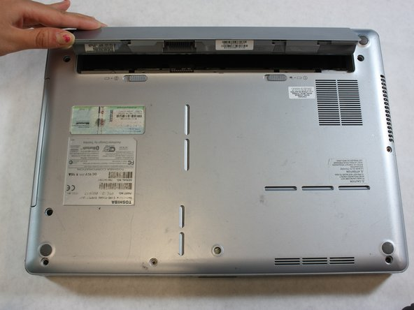 Pull the battery out by lifting the battery cover away from the laptop.